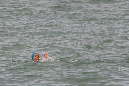 """Betty (PHOTO) """"ourse blanche"""" de 92 ans et le docteur Guillaume Barucq lors de leur sortie de baignade dans l'océan à la plage du port vieux de Biarritz le 10 novembre 2020. Confinement baigneur en colere, des ainés entre autres, des Ours Blancs une association mythique de Biarritz au Pays basque, interdits de baignade malgrès un avis médical en leur possession, BETTY agée de 92 ans, commence à faire parler d'elle avec cette """"altercation"""" avec la police, des slogans comme LAISSZ NAGER BETTY et LET BETTY SWIM et DU SPORT SUR ORDONNANCE  VAUT MIEUX QUE DES MEDICAMENTS apparaissent sur le fil sur les reseaux sociaux. Les Ours blancs sont à l'eau l'année,médiatisés surtout pour leur traditionnel bain de Noël , plage du Port-Vieux, leur règle d'or pour l'hiver quand l'eau est très très froide est de se baigner autant de temps qu'il y a de degrés dans l'eau mais pas plus.   Betty """"white bear"""" of 92 years and doctor Guillaume Barucq during their bathing trip in the ocean at the beach of the old port of Biarritz on November 10, 2020. Containment of an angry bather, elders among others, White Bears a mythical association of Biarritz in the Basque Country, banned from bathing despite a medical opinion in their possession, BETTY aged 92, begins to make talk about her with this """"altercation"""" with the police, slogans like LET BETTY and LET BETTY NAGER SWIM and PRESCRIPTION SPORT IS BETTER THAN DRUGS appear on social media feed. The Polar Bears are in the water year round, especially publicized for their traditional Christmas swim, Port-Vieux beach, their golden rule for winter when the water is very very cold is to bathe as many time that there are degrees in the water but not more.  Biarritz, Pays basque, 64 , Nouvelle Aquitaine, Pyrénées Atlantiques, Sud Ouest, France, Europe, New Aquitaine, Basque Country."""